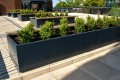 40psr27 - Stratum long planters with Bexley benches