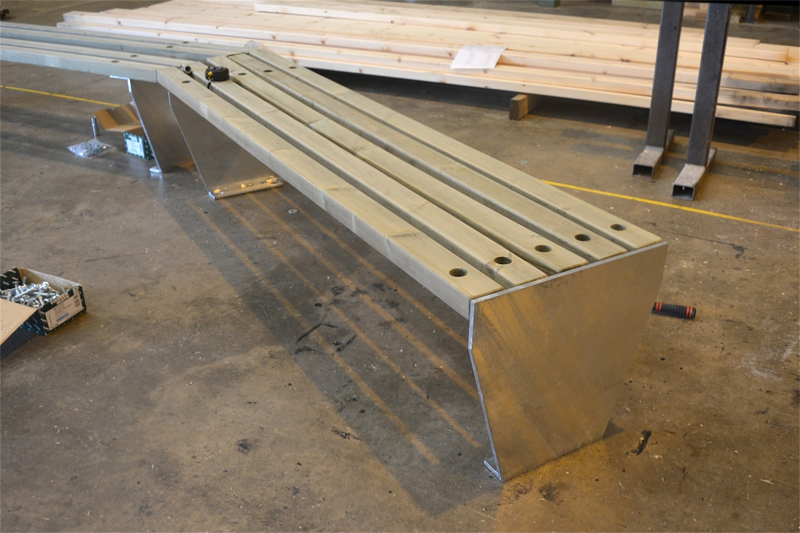 c121t02 - Angled timber slatted bench in manufacture