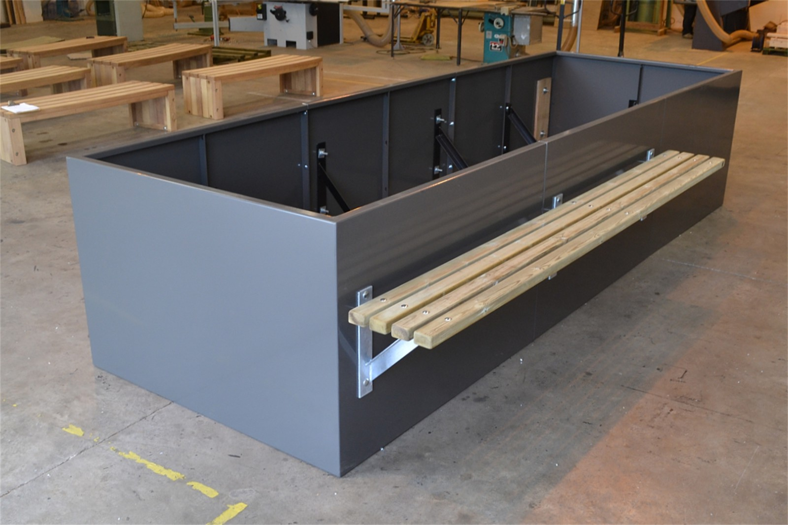 c121v03 - Stratum planter walling with bench in manufacture