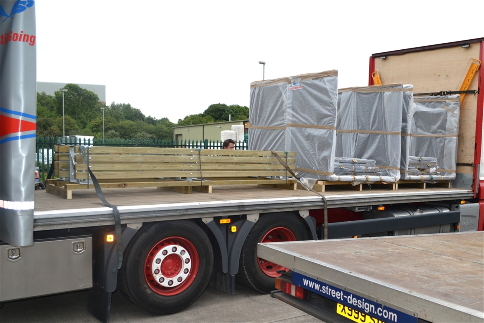 c121v06 - Planters and benches loaded for delivery to site