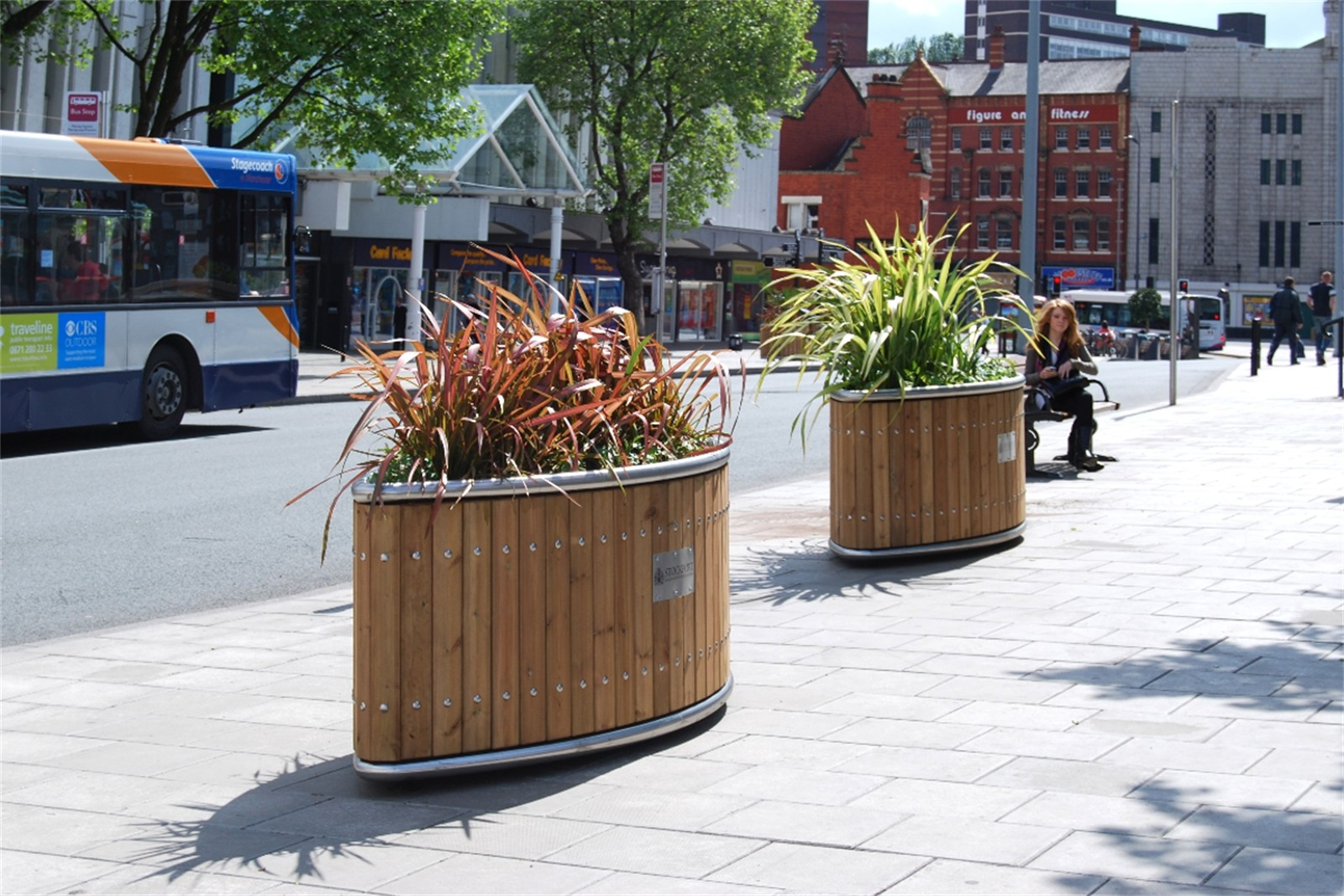 c12806 - elliptical planters with optional plaques supplied to Stockport Town Centre