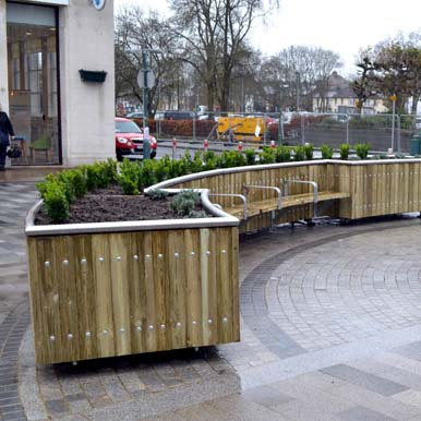 Versatile Castleton Curved Planter with Seating by Street Design